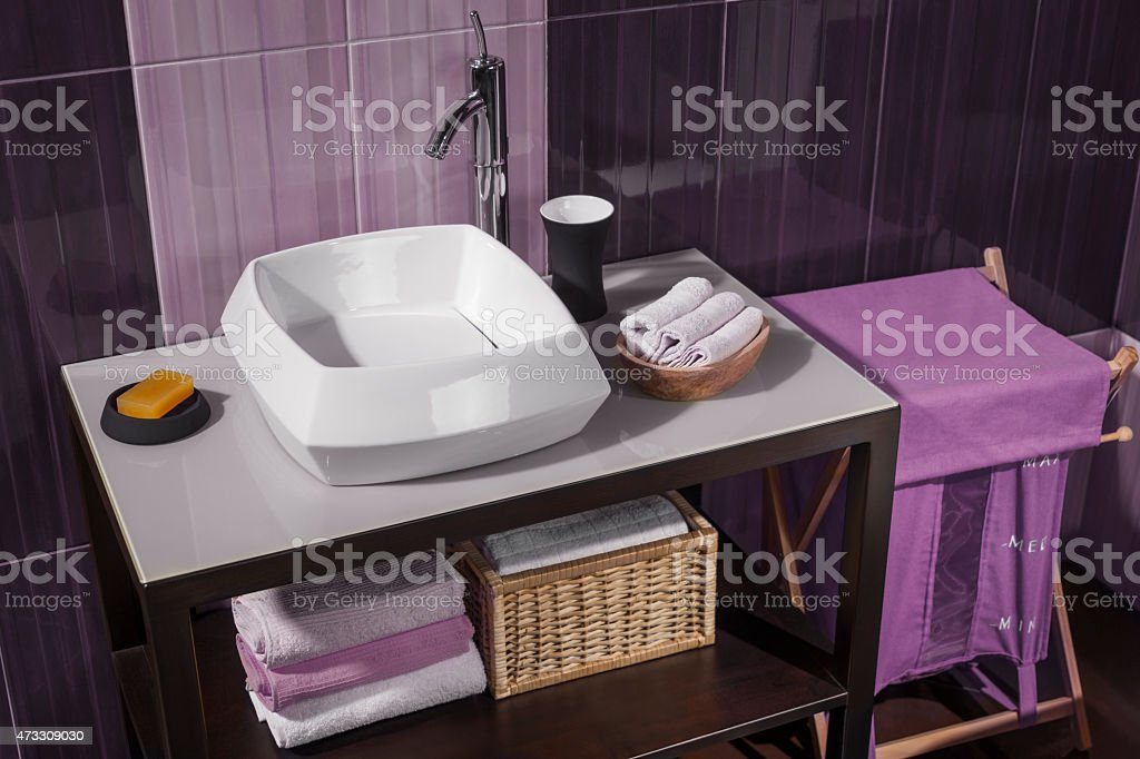 detail of a modern bathroom with sink and accessories_05 stock photo
