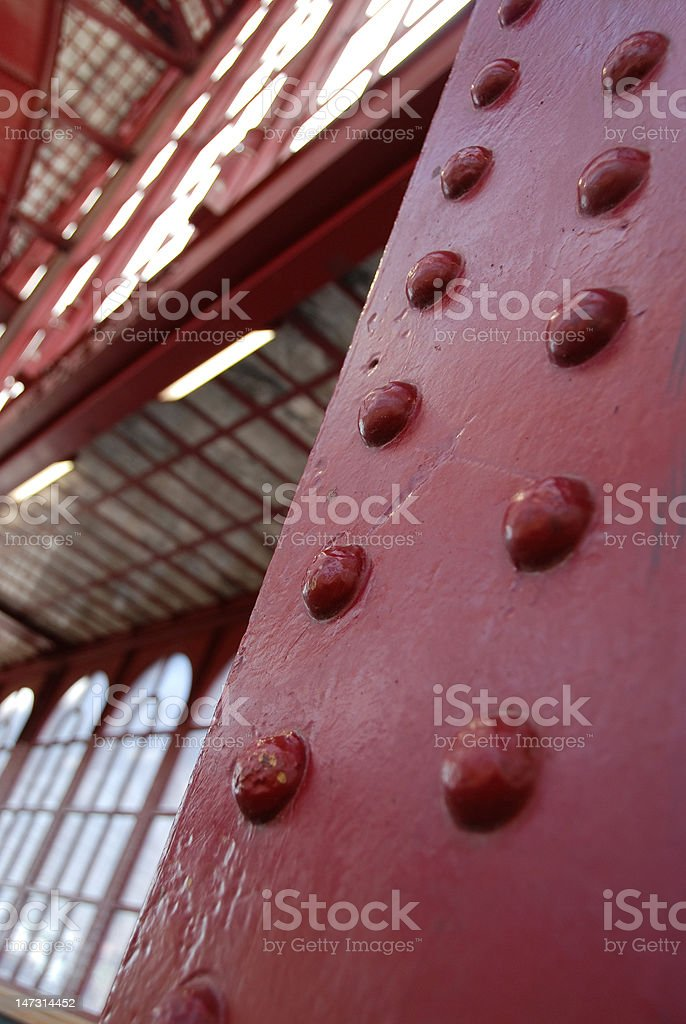 Detail (rivets) of a red art nouveau station hal. royalty-free stock photo