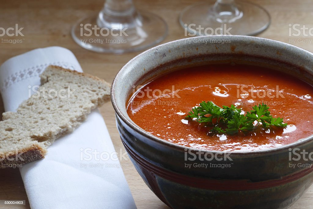 Detail of a red vegetable soup in a pottery bowl stock photo