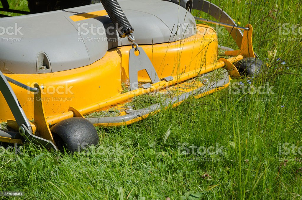 Detail of a riding lawn-mower stock photo