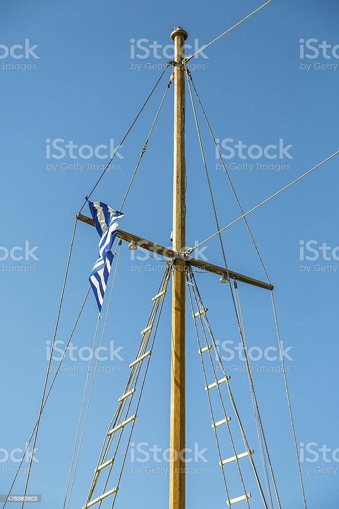 detail of a ship's mast with greek flag royalty-free stock photo
