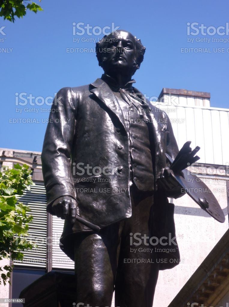 Detail of a statue of the Victorian painter Sir John Everett Millais by Sir Thomas Brock, located outside Tate Britain, London, England stock photo