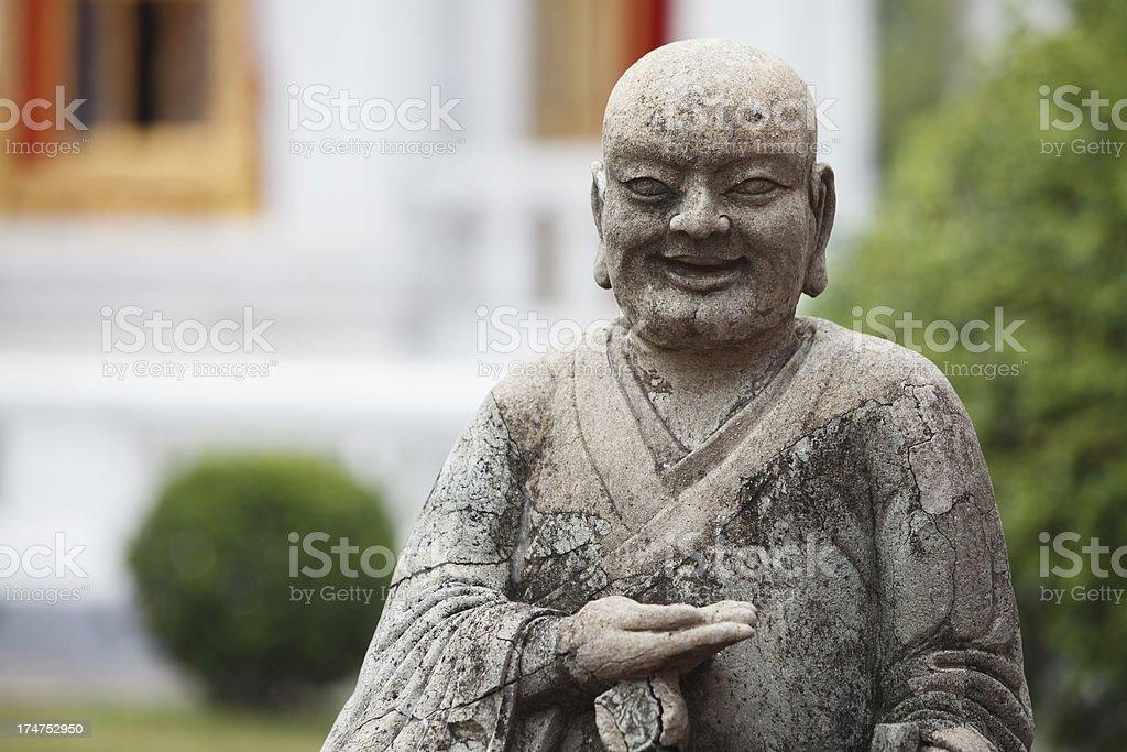 Detail of a stone Buddha statue stock photo