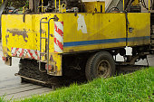 detail of a street sweeper machine car cleaning the road
