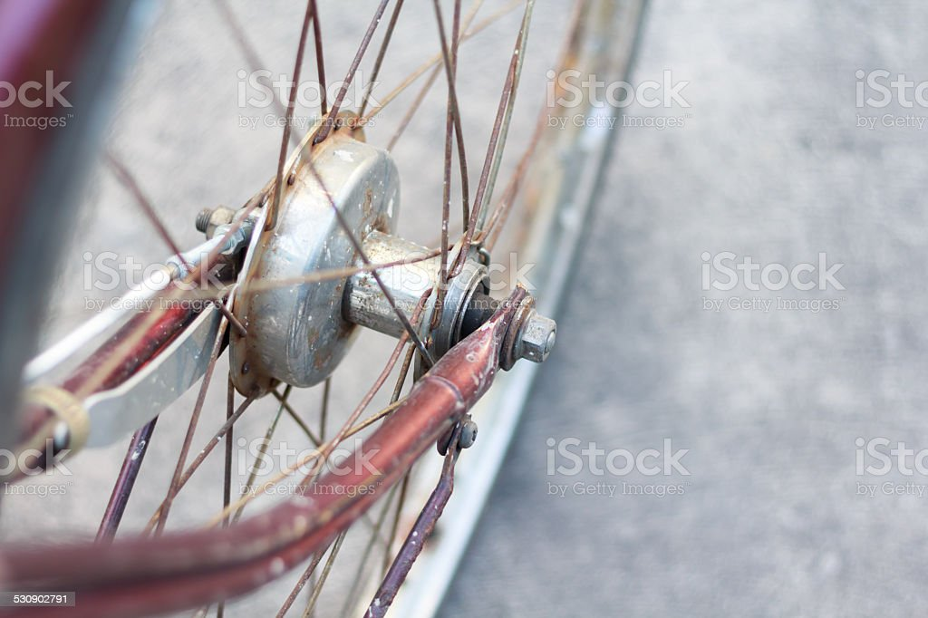 Detail of a Vintage Bike wheel with background texture stock photo