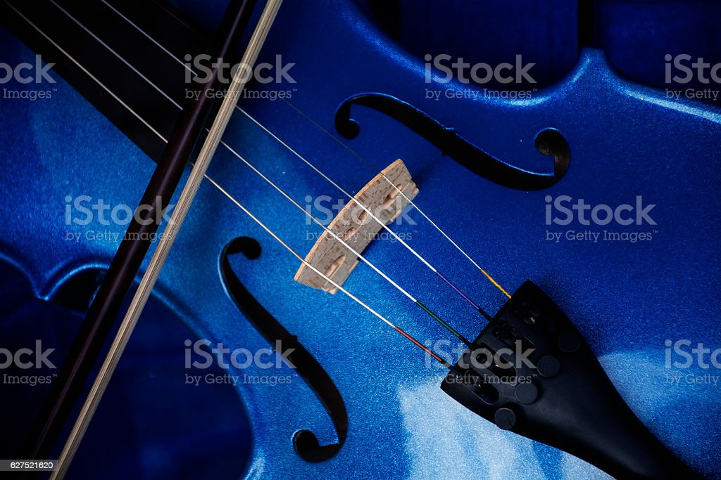 Detail of a violin with blue glitter varnish, music instrument stock photo