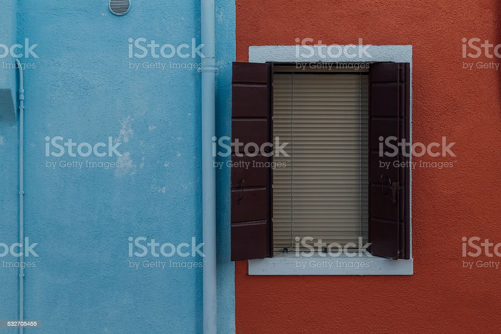 Detail of a Window on a Colorful Wall in Venice stock photo