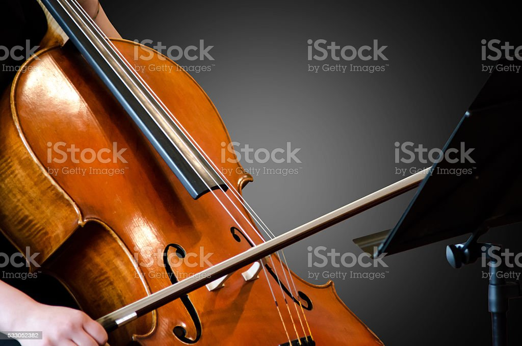 Detail of a woman playing cello stock photo