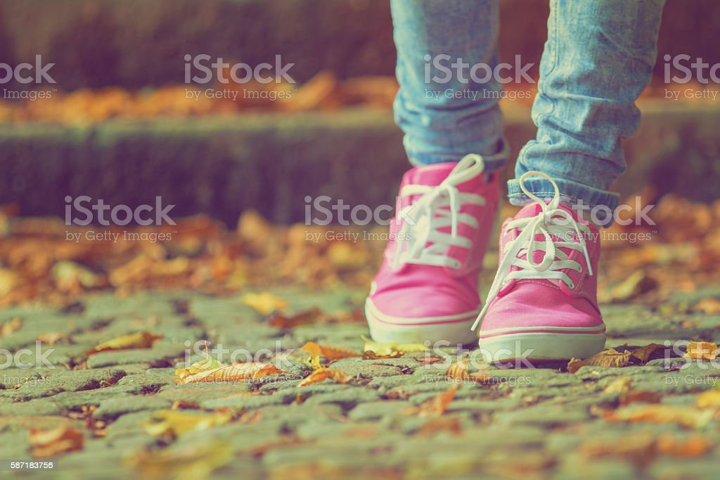 Detail of a woman's shoes while walking. stock photo