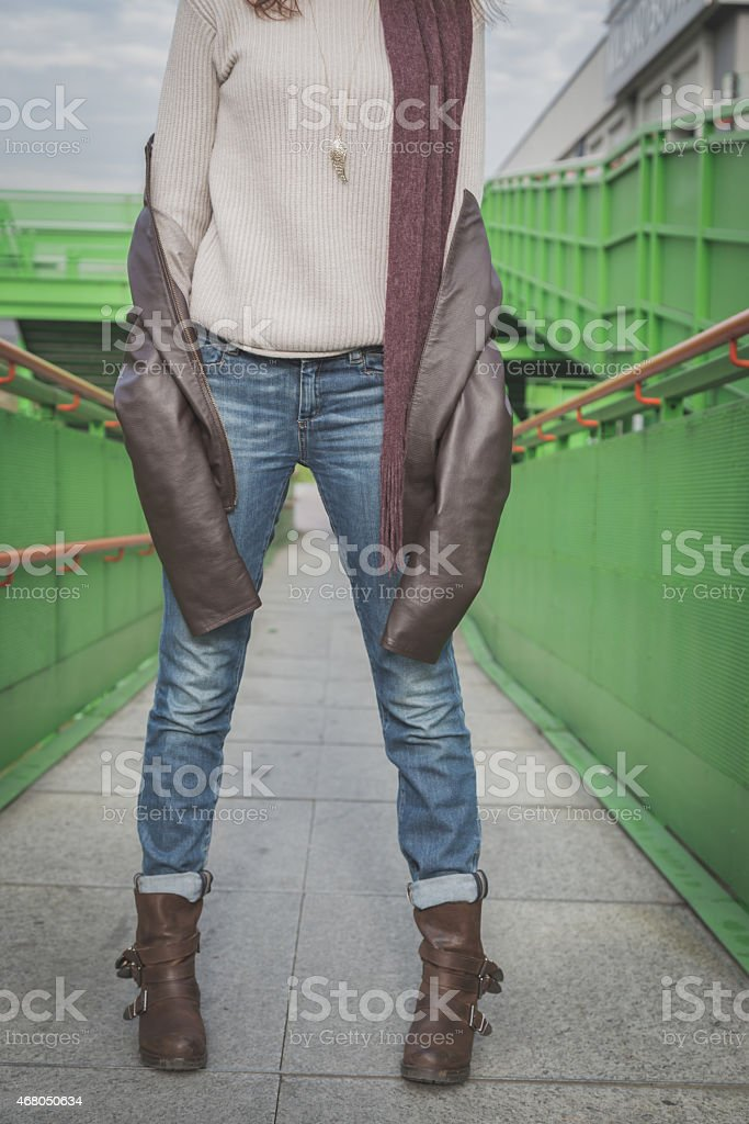 Detail of a young woman posing on a bridge stock photo