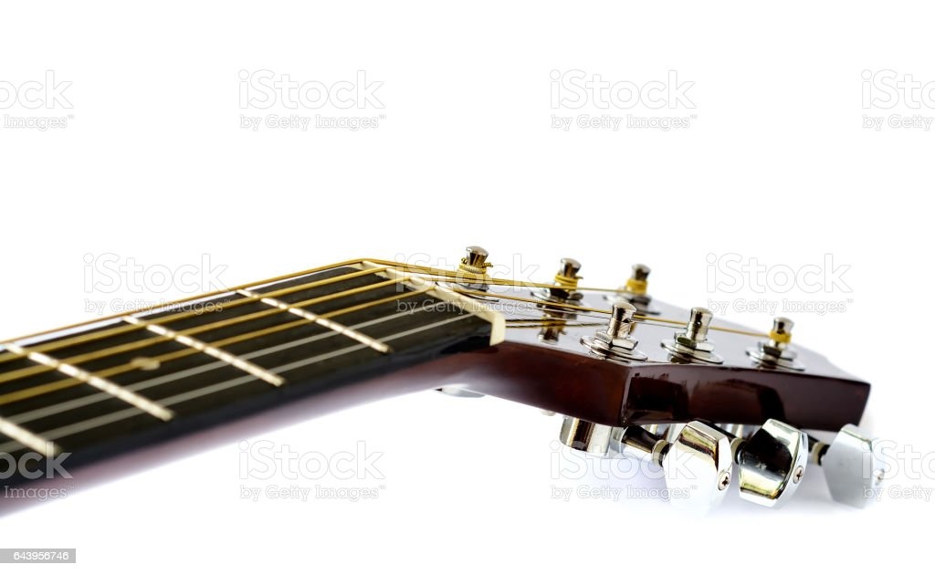 Detail of acoustic guitar with shallow depth of field on white background stock photo
