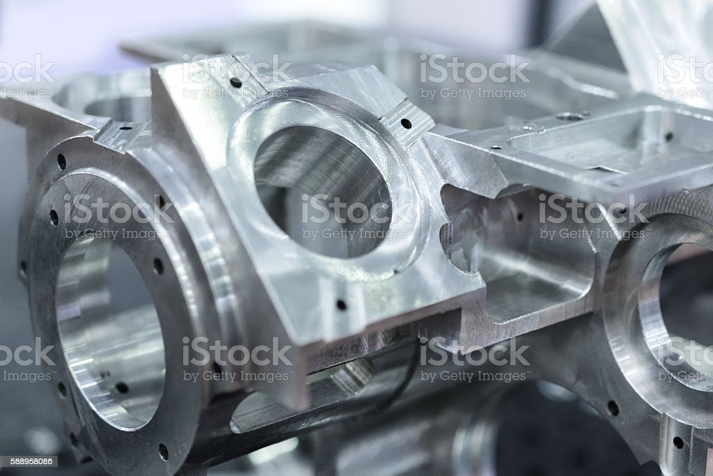 Detail of aluminum machined parts, shiny surface. stock photo