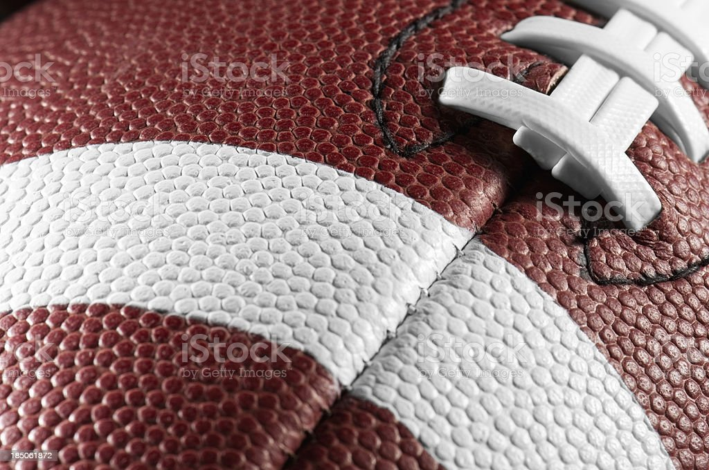 Detail of American Football with white lacing and stripes royalty-free stock photo