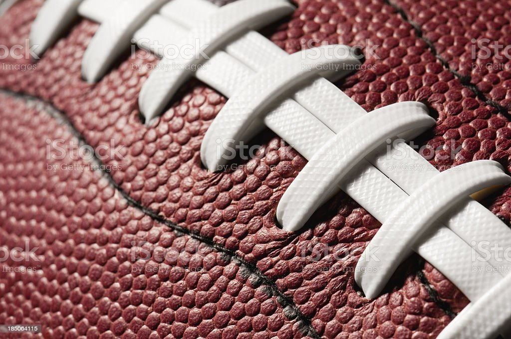 Detail of American Football with white lacing royalty-free stock photo