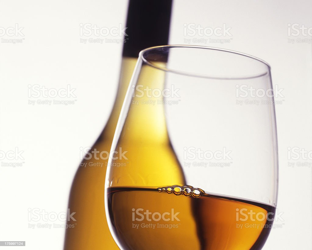 detail of an alcoholic beverage in glass with bottle stock photo