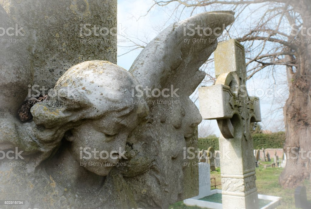 Detail of an Angel Monument in an old cemetery stock photo