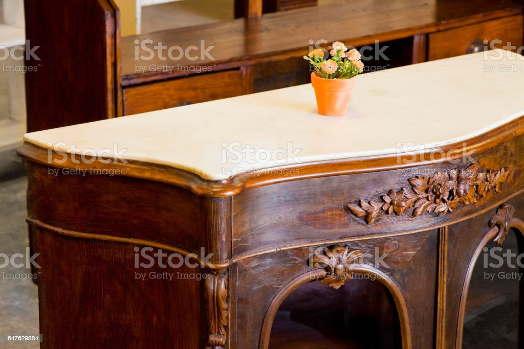 Detail of an antique wooden italian furniture just restored with floral decorations stock photo