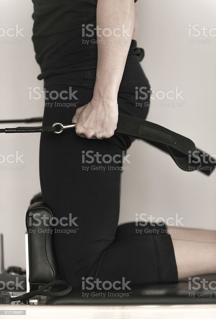 Detail of an arm realising in exercise of pilates stock photo
