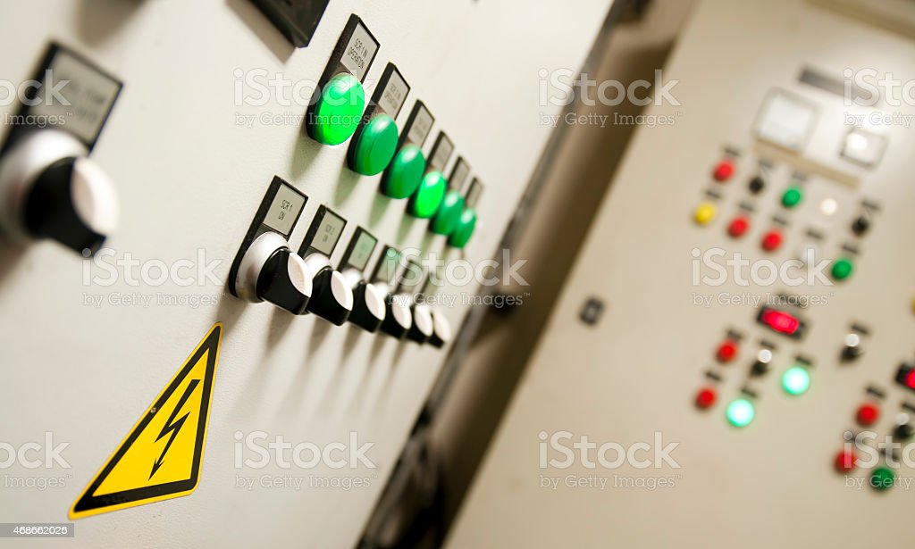 Detail of an engineering control room with control switches stock photo
