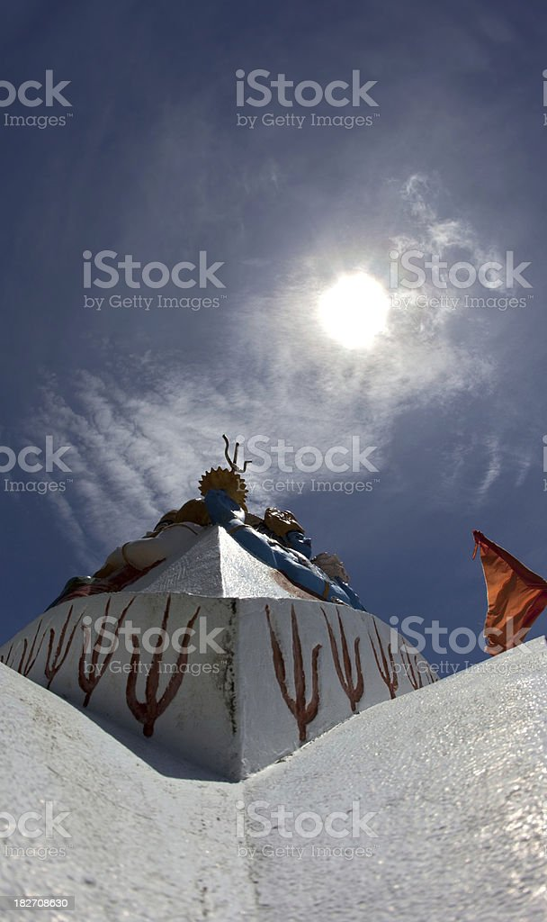 Detail of an Hindu temple with Shaivite trishula symbols stock photo
