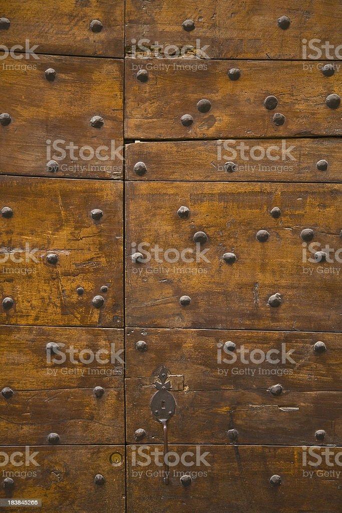 Detail of an oak door with rivets stock photo