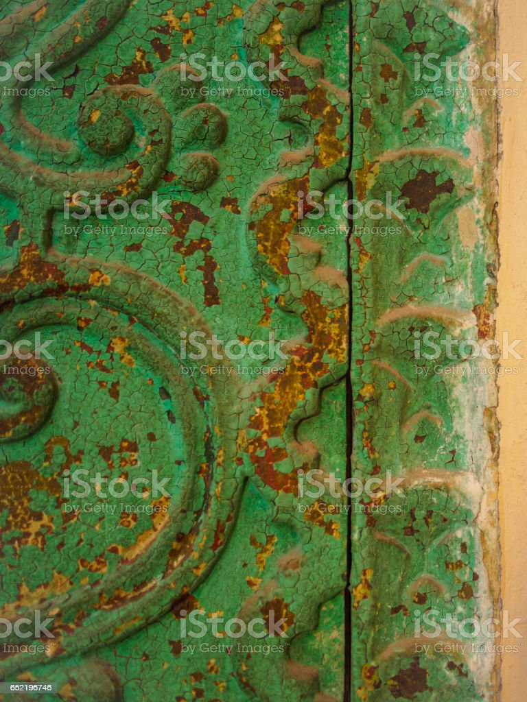 Detail of an old and rusted iron door, turquoise color, in Arequipa Convent of Santa Catalina stock photo