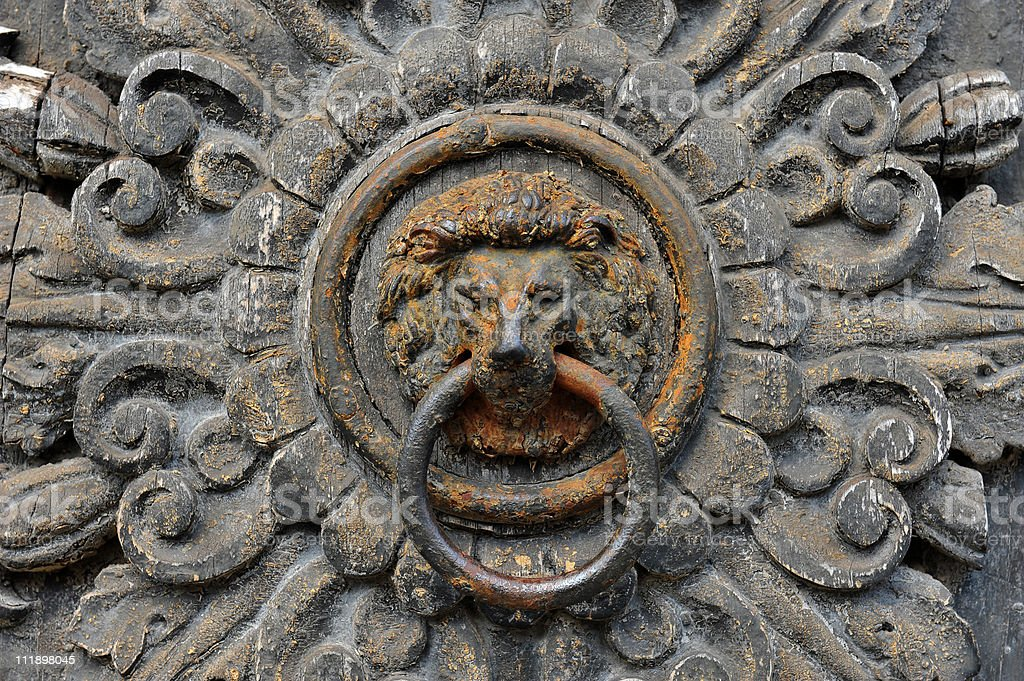 Detail of an old door knocker royalty-free stock photo