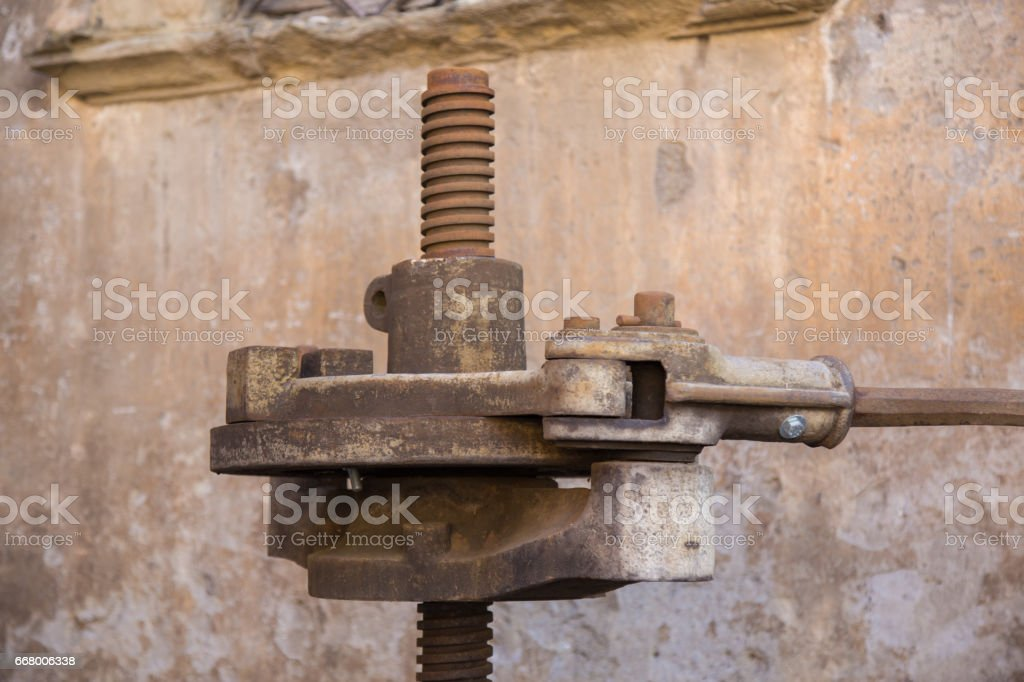Detail of an old press for pressing the grapes and get the wine. stock photo