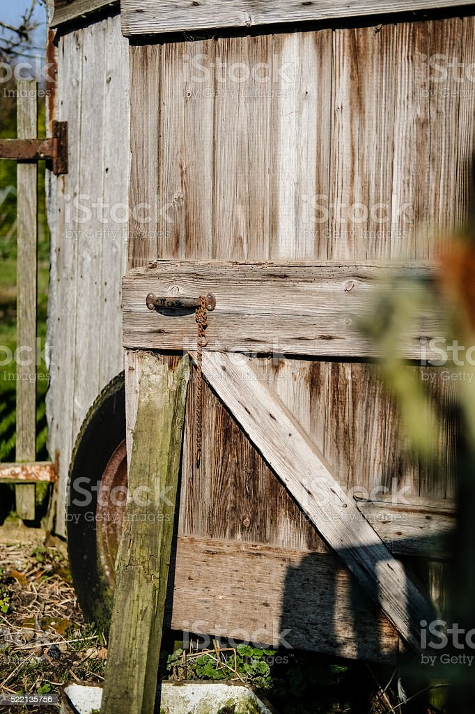 Detail of an old shed door in a farmyard setting stock photo
