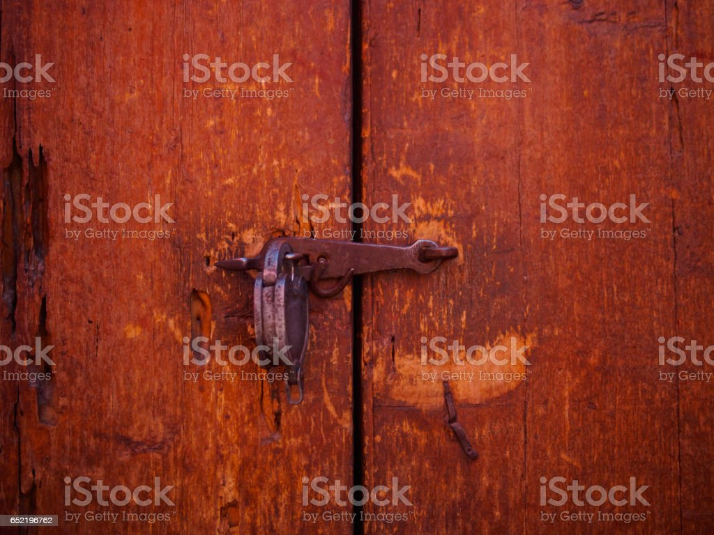 Detail of an old wood door closed with padlock, close-up stock photo