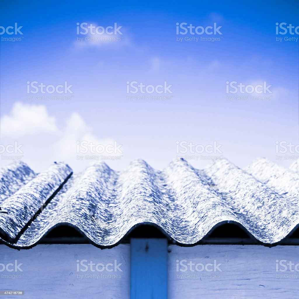 Detail of an olf dangerous asbestos roof stock photo