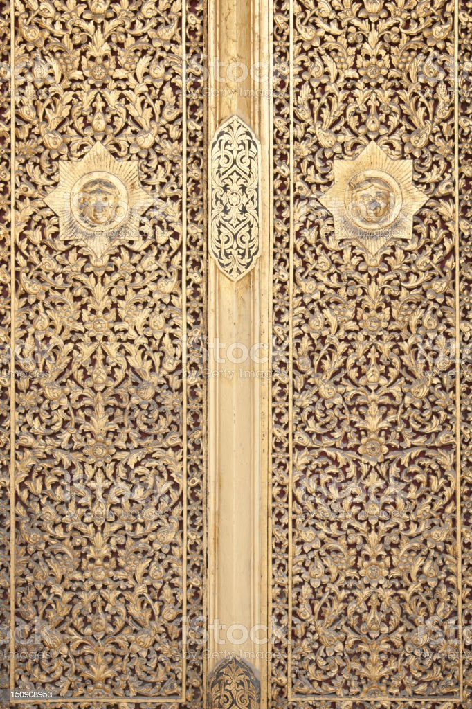Detail of art on door at temple in Bangkok, Thailand royalty-free stock photo