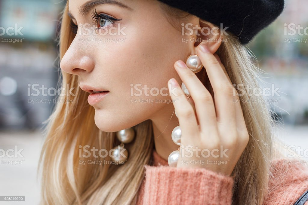 Detail of beautiful woman with earring stock photo