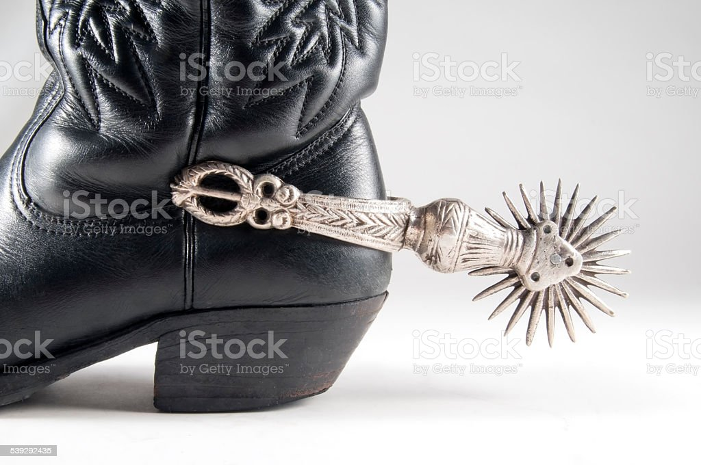 Detail of black boot cowboy with spur stock photo