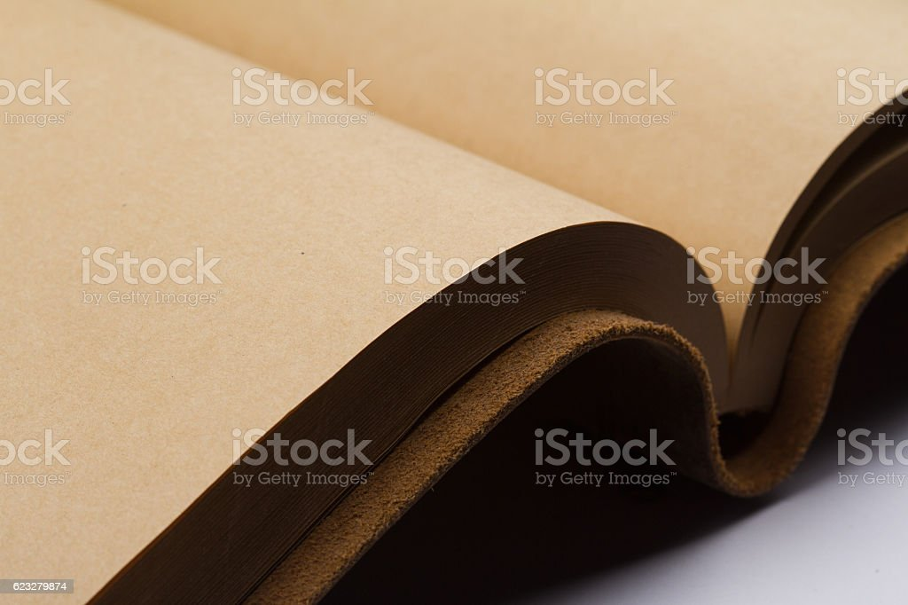 detail of blank pages of a leather covered book stock photo