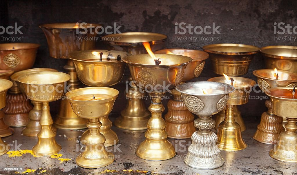 Detail of burning candles in buddhist monastery stock photo