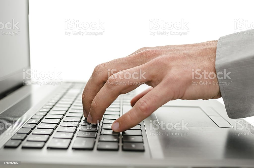 Detail of business man hand using laptop royalty-free stock photo