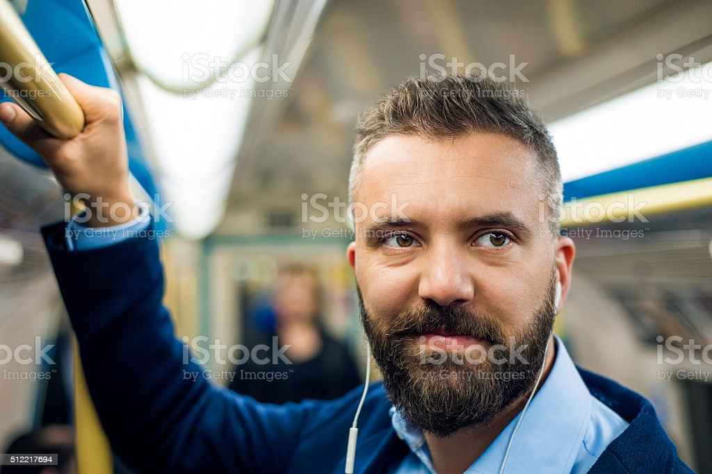 Detail of businessman travelling to work. Inside underground wag stock photo