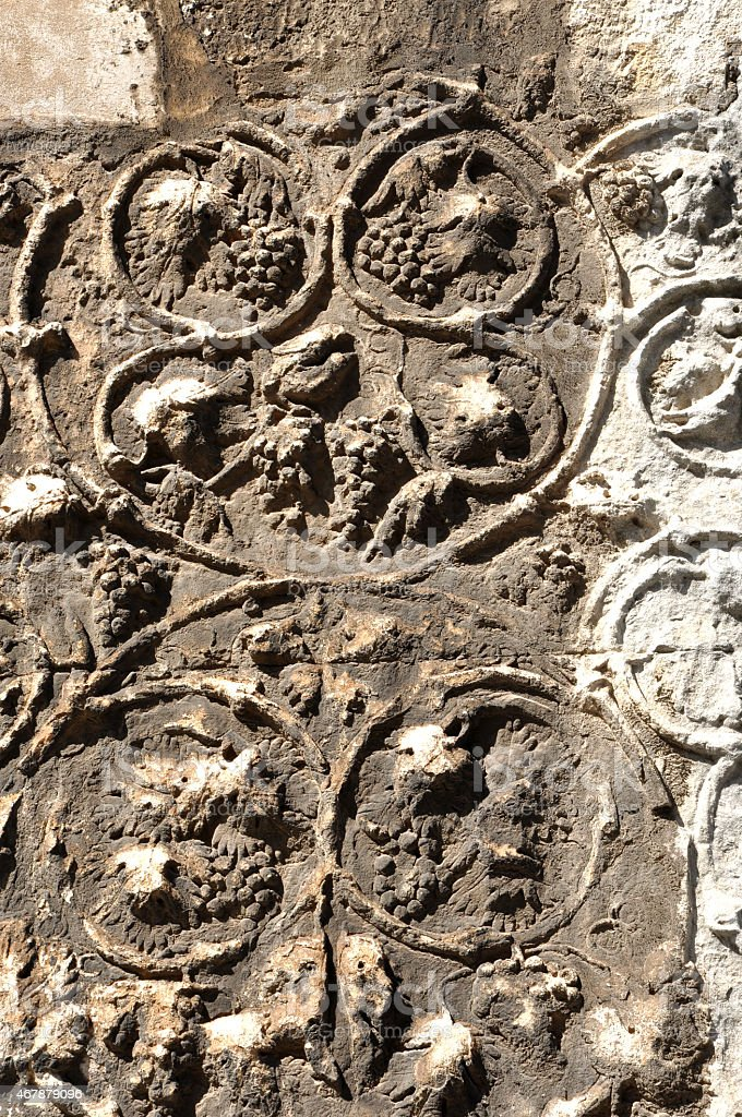 Detail of carved stone with grape stock photo