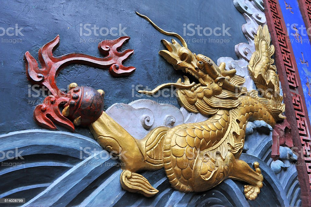 Detail of Chinese dragon on wall stock photo