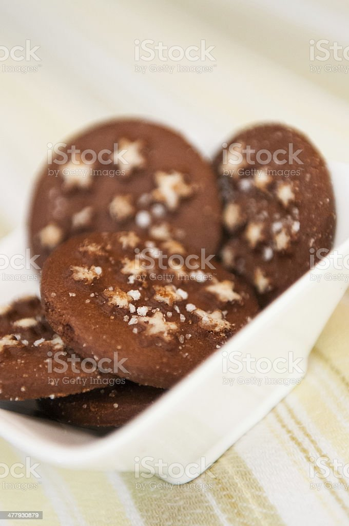 Detail of Christmas holiday dark chocolate cookies with white stars stock photo