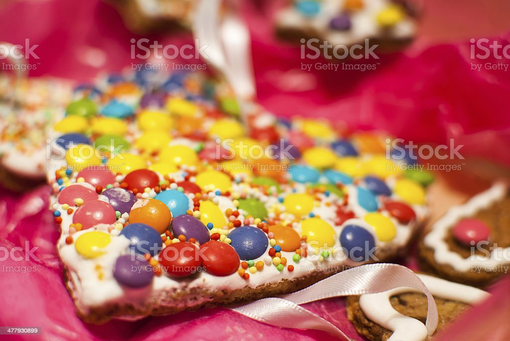 Detail of Christmas holiday heart shape M&M's like cookies stock photo