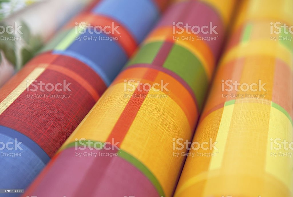 Detail of colored plastic tablecloths on a market stall royalty-free stock photo