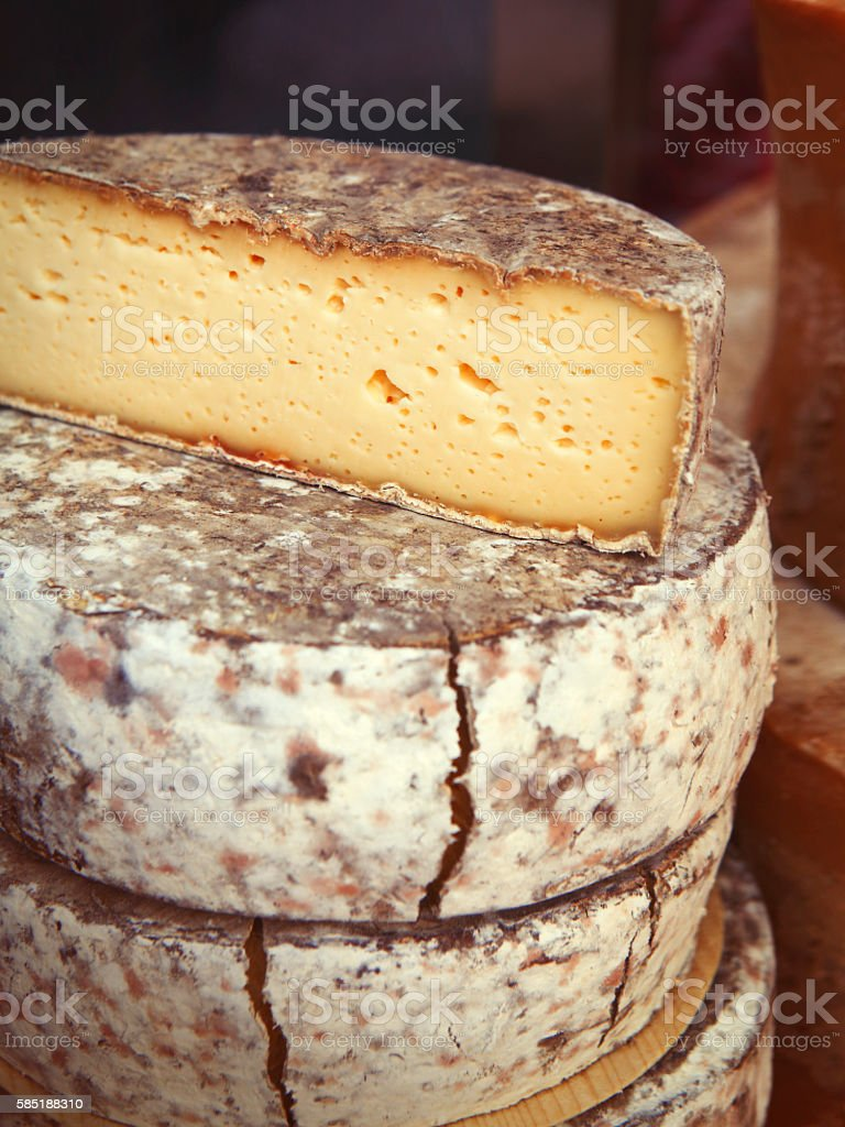 Detail of cut french round ripening cheese stock photo