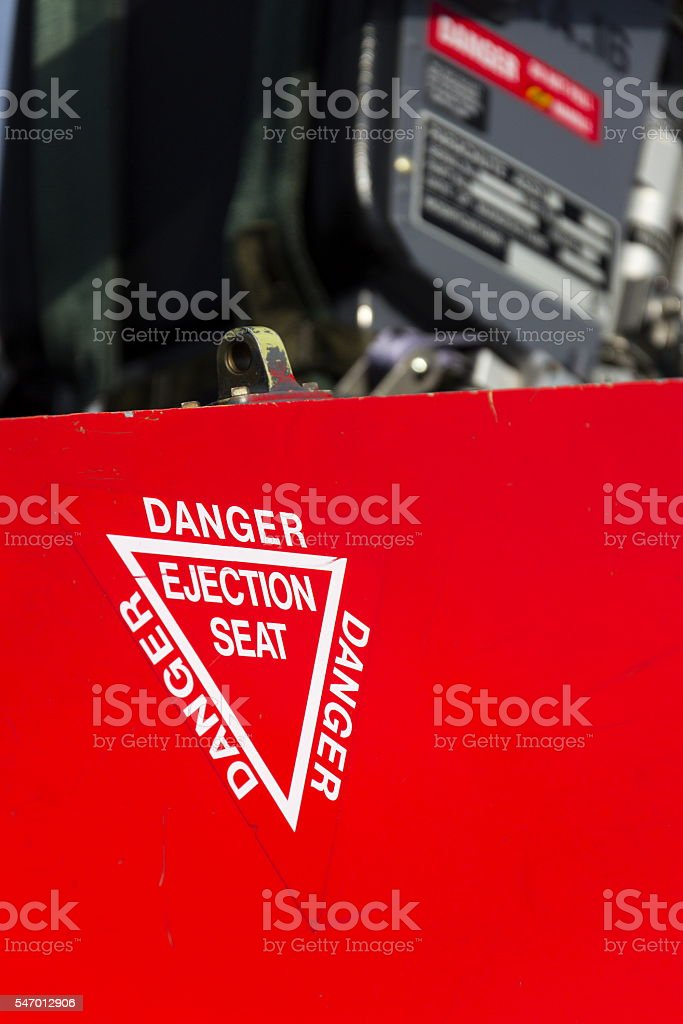 Detail of danger ejection seat warning sign on jet airplane stock photo