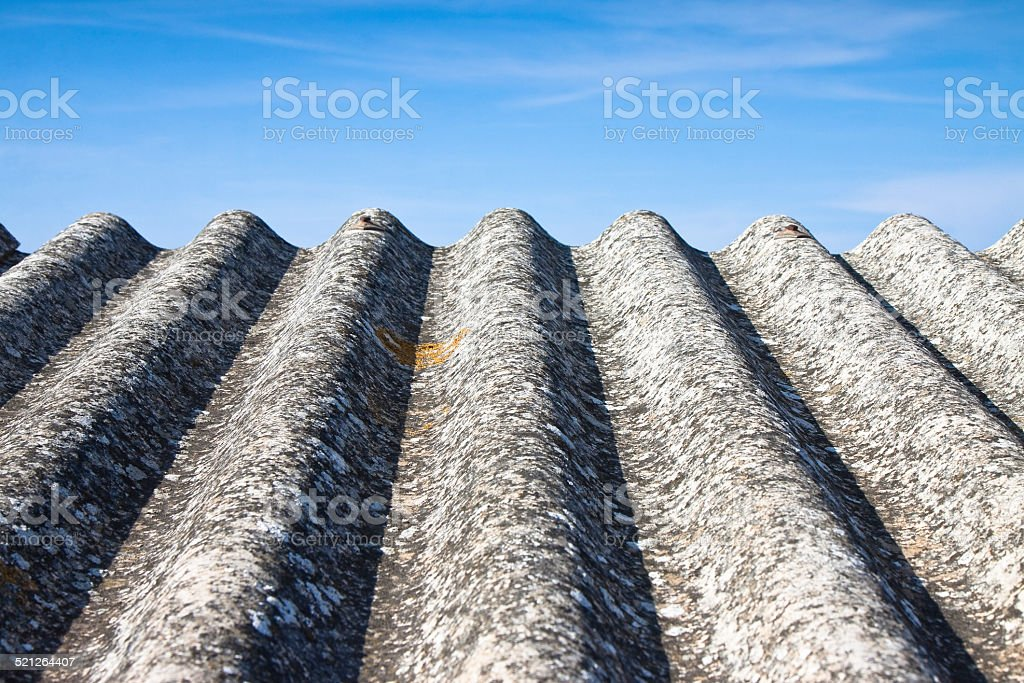 Detail of dangerous asbestos roof stock photo