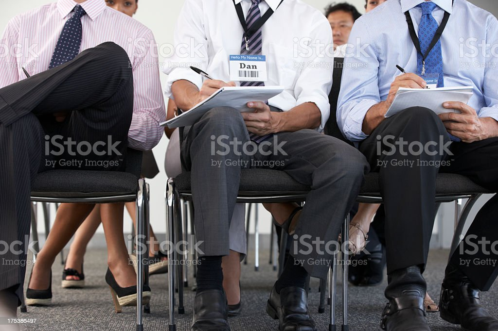 Detail Of Delegates Listening To Presentation At Conference stock photo