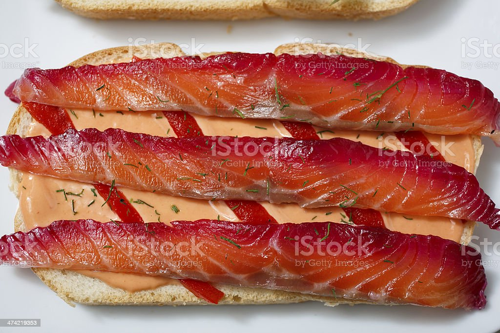 Detail of Delicious Part of a Sandwich of Gravlax stock photo