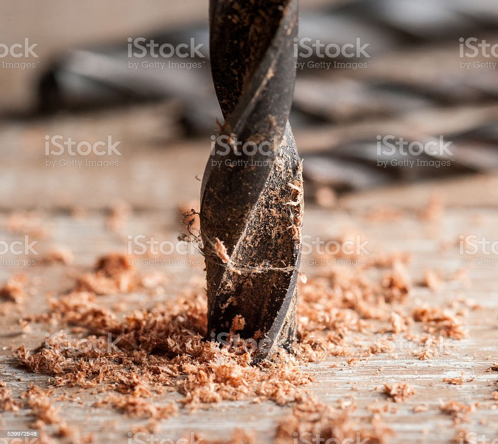 Detail of drill bit in a piece of wood stock photo