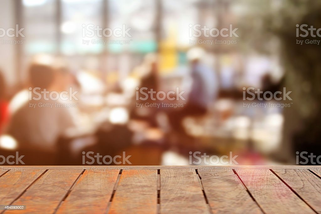 Detail of empty table in a sunny restaurant, defocused background stock photo